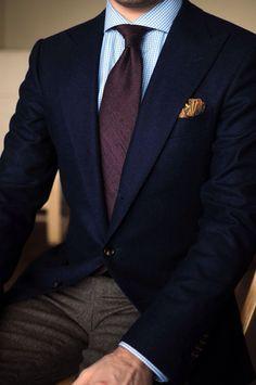 Navy peak lapel blazer, charcoal pants, blue gingham shirt, maroon raw silk tie