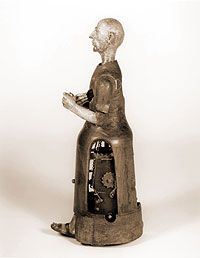 Mechanical Monk, 1560   Tradition attributes his manufacture to one Juanelo Turriano, mechanician to Emperor Charles V. The story is told that the emperors son King Philip II, praying at the bedside of a dying son of his own, promised a miracle for a miracle, if his child be spared. And when the child did indeed recover, Philip kept his bargain by having Turriano construct a miniature penitent homunculus