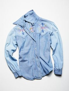 Vintage 1970s Embroidered Denim Shirt | This vintage from the 1970s embroidered denim buttondown features allover hand embroidery detailing. In a western silhouette this style has snap button closures down the front.