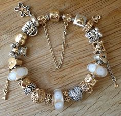 Pandora bracelet with two tone, gold and white charms