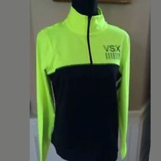 Victoria's Secret VSX track jacket Black track jacket with no hood and a zipper close. With green color block. Victoria's Secret Tops Sweatshirts & Hoodies