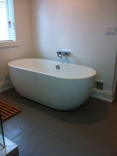Free Standing Tub On Tile And Rest Of Bathroom In Wood Bathroom Design Pi