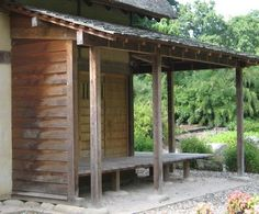 dark wood siding and simple wood porch