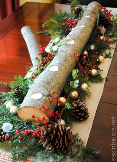 christmas greenery centerpieces | Log Centerpiece using natural greenery, berries, pinecones, and a few ...