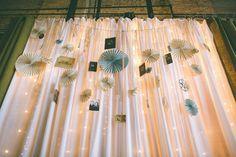 Back drop garland with family photos and pinwheels