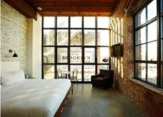 the wythe hotel - it's an old turn-of-the-century factory converted to a 72 room hotel in brooklyn on the waterfront