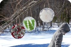 if I lived in a place where it stayed below freezing for a substantial period of time I would make these-> leaves ect. in a pan with water, frozen then hung on trees around- Ice Mandalas