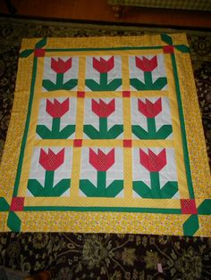 Beautiful Tulip quilt posted by Susan on The Quilting Board