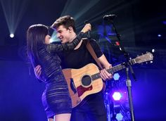 Camilla Cabello and Shawn Mendes perform onstage during 103.5 KISS FM's Jingle Ball 2015