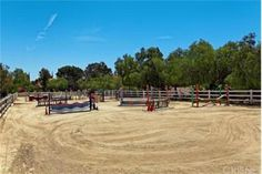 The exterior offers an huge, OLYMPIC -SIZE DRESSAGE ARENA, with stalls, and a barn. Ample of entertainment options with a huge sparkling pool, patios, several conversation areas with fire pits, a Koi pond and an expansive backdrop of the surrounding mountains and valleys.