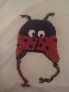 Crochet Lady Bug Beanie with Ear Flaps.  Selling for $25.00 plus Shipping & Handling.  Can also be seen on Facebook and Etsy.