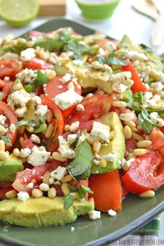 Avocado Tomato Salad with Pine Nuts + Feta | wholeandheavenlyoven.com