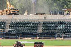 Field maintenance continues amid construction work at PNC Field Thursday, July 12, 2012.