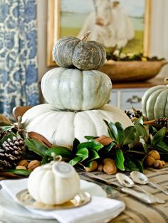 Stack a Rustic Centerpiece Colorful heirloom-variety pumpkins create a chic centerpiece when stacked and surrounded by other natural fall elements. To create a stable base, first remove the stems from all but the top pumpkin and add double-sided tape between the layers if you need a bit more stability.    35 Halloween Pumpkin Ideas - Carved, Painted, Designs & Decorating | HGTV http://www.hgtv.com/design/make-and-celebrate/entertaining/our-favorite-pumpkin-ideas-for-halloween-pictures
