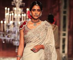 """50 Saree Blouse Designs That Will Amaze YouDeb: Altho, my perfect """"red"""", I would remove the """"caps"""". And change up the lift the Sari over my other my shoulder, for dinner. Later, outside in deck, I would keep the shoulder pinned....but move the rest around my back draped off the shoulders for a shawl."""