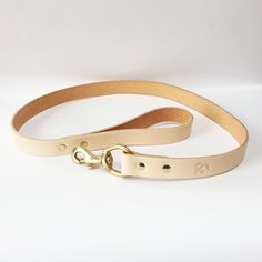 NEW! This designer leather dog lead from London brand Fetch & Follow, is perfect for the sophisticated dog about town, or the rough and ready country hound. Pair it with the matching leather dog collar or hound collar to complete the look.