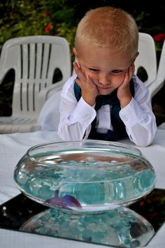 Way cool idea- have fishbowls as centerpieces with the color fish that themes your wedding then afterwards give the fish as favors to the flower girl, ring bearer, etc.