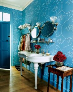 Custom-colored Mauny 1930s-design wallpaper in the master bathroom of designer Rachel Riley's château on the Loire in France.