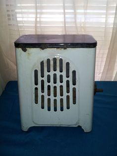Gas heaters on pinterest vintage bathroom tiles old for Small bathroom heater
