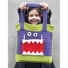 Free Crochet Tote Pattern--The 'Monster Ate My Homework' Tote--With lots of room and three front pockets, kids (both young and young at heart) will love carrying books, toys, or groceries in this fun monster bag.