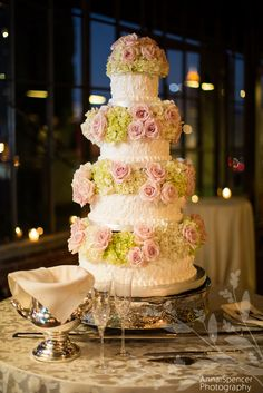 Anna and Spencer Photography Atlanta Wedding Photographers . Wedding Cake with pink roses and green hydrangeas at a Reception at Summerour in Atlanta . Cake by Classic Cheesecakes in Atlanta .