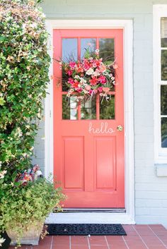Coral front door is sure to catch the eyes of passer-bys. Just beautiful!