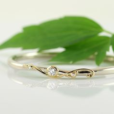 Morningdance elven bracelet of solid white gold with diamonds set in 18k yellow gold