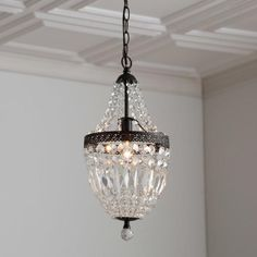 Evelynne Crystal Chandelier Inspired by glamorous 19th-century French empire lighting, this crystal and metal mini chandelier features elegantly draped strands that cascade into a basket silhouette.