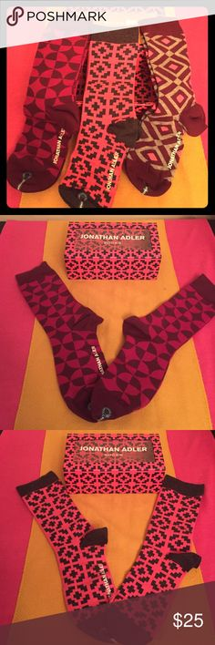 Jonathan Adler Socks Gift Set, 3 PK Authentic Jonathan Adler Crew Socks Gift Set, 3 PK. Women & Girls. 9-11. 1-Wine Geometric Print. 2-Pink & Charcoal Grey Geometric Print. 3-Wine & Pink Geometric Print. All have Solid Cuffs, Heels, and Toes. Plus Jonathan Adler White Graphics on the Foot of 1 Sock per pair. 80% Cotton/18% Nylon/2% Spandex. Brand New in their Original Gift Box the same color as Sock#2. Excellent Condition. No Trades. Jonathan Adler Accessories Hosiery & Socks