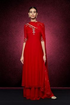 Ravishing Red Divitha Suit by Anita Dongre with red palazzos and silver embroidery work for the Traditional indian bride | Every Indian bride's Fav. Wedding E-magazine to read.Here for any marriage advice you need | www.wittyvows.com shares things no one tells brides, covers real weddings, ideas, inspirations, design trends and the right vendors, candid photographers etc.