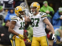 January 18, 2015; Seattle, WA, USA; Green Bay Packers wide receiver Randall Cobb (18) is congratulated by wide receiver Jordy Nelson (87) after scoring a touchdown against the Seattle Seahawks during the first half in the NFC Championship game at CenturyLink Field. (2304×1732)
