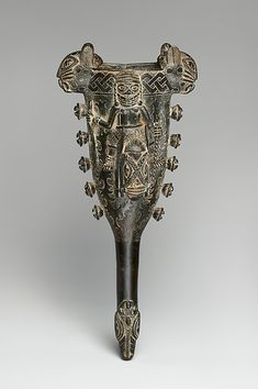 Bell (Ekure) Date:early century Geography:Court of Benin, Nigeria Culture:Edo Medium:Brass × 6 × 4 in. × 17 × cm) Classification:Idiophone-Struck-bell-without clapper Ancient Artefacts, Fantasy Story, African Jewelry, West Africa, Metropolitan Museum, African Art, Black History, Musical Instruments, Metal Working