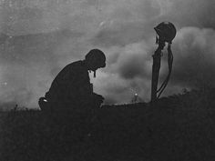 """A Marine mourns the loss of a friend during the Battle of Okinawa, Okinawa, Loss Of A Friend, Soldier Silhouette, War Photography, Total War, Remembrance Day, Military Men, World War Two, Wwii"