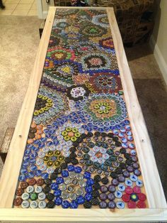 Hand crafted pong table with bottle cap design