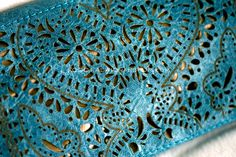 laser cut clutch    IMAGE    Contemporary reference - laser cutting used in textiles, how shapes can be cut out of fabric