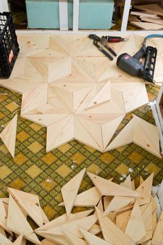 Cool! DIY Geometric Wood Floor... Easy DIY with cheaper wood