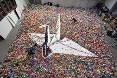 Origami Crane Made from . Origami Cranes: A Flapping Success for Japan Earthquake Relief Vik Muniz Critique D'art, Japan Earthquake, Instalation Art, Origami Paper, Origami Cranes, Hanging Origami, Building Images, New York Studio, New York Times Magazine