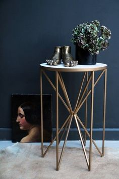Add a touch of playful geometric design to your room with this Butterfly Side Table, now available in our favourite design duo - Brass & White Marble!With an eye-catching brass base and white marble top, this side table is the ideal piece to add Side Table Decor, Brass Side Table, Table Decorations, Side Tables, Marble End Tables, Diy Table, Unique Coffee Table, Coffee Table Design, Coffee Tables