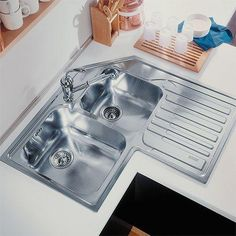 This stainless steel corner sink from Franke works perfectly in compact or small kitchens to ensure that you don't feel claustrophobic and have ample space for preparation. Franke Kitchen Sinks, Electronic Kitchen Scales, Corner Sink Kitchen, Modern Bathroom Accessories, Tiny House Layout, Space Saving Kitchen, Custom Kitchens, Small Kitchens, Indian Home Decor