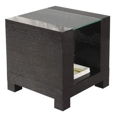 The simple, yet solid Heathe End Table is available with your choice of wheels or wooden legs. This modern side table features a rich wenge finish and a clear tempered glass top. A matching cocktail table is also available. $329.00