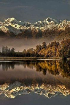 Reflection: This photo is amazing, it's so beautiful as the mountains and trees look amazing in the reflection on the water