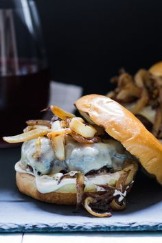 Nothing beats a burger hot off the grill! This one is topped with caramelized onions and melted Gruyère for