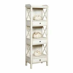 "Showcasing 3 shelves with accompanying drawers, this bookshelf is finished with x-shaped latticing and an antiqued white hue. Product: BookcaseConstruction Material: WoodColor: WhiteFeatures: Three drawersThree stationary shelvesDimensions: 67"" H x 22"" W x 14"" D"