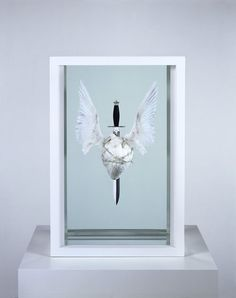 Damien Hirst, The Immaculate Heart - sacred; 2008 bulls heart, acrylic, steel, dagger, dove wings, silver barbed wire and formaldehyde solution