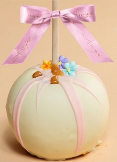 Dunked Caramel Apple w/ White Belgian Chocolate & Candy Flowers - All of our gourmet caramel apples come with a complimentary copper embossed apple box to not only protect during shipping but to show as an elegant gift ready gift box.  Share some love with something not only unique and decadent but handmade with quality and passion!
