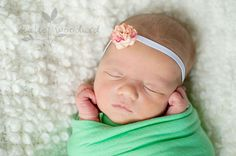 http://www.katiewoodardphotography.com/blog/ - sweet wrapped newborn