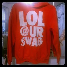 "Hoodie ""LOL @ UR SWAG"" orange hoodie. Tag says ""small"", but runs big (Medium or Large). Front pocket. Barely worn! Tops Sweatshirts & Hoodies"