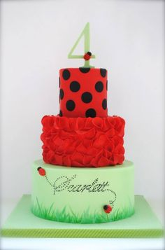 Ladybug Cake - Scrunch roses on middle tier (fondant circles scrunched into a petal). Handpainted grass and ladybug trail on bottom tier.
