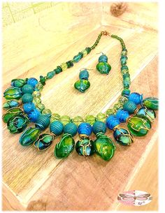 Green and Blue glass and acrylic beads with hand wrapped wire with matching earrings from ramonacordelia.com