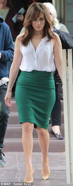 Traffic stopper: The singer and actress wore a flattering form-fitting green skirt as her costume
